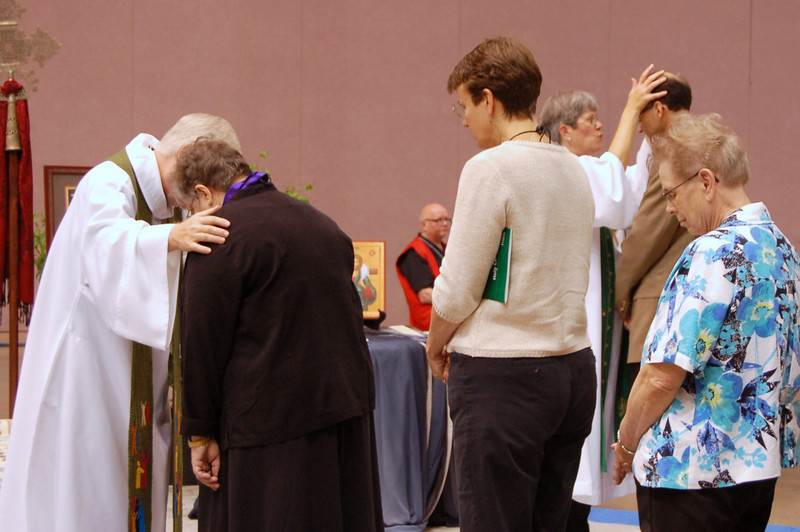 Receiving the sign of the cross.