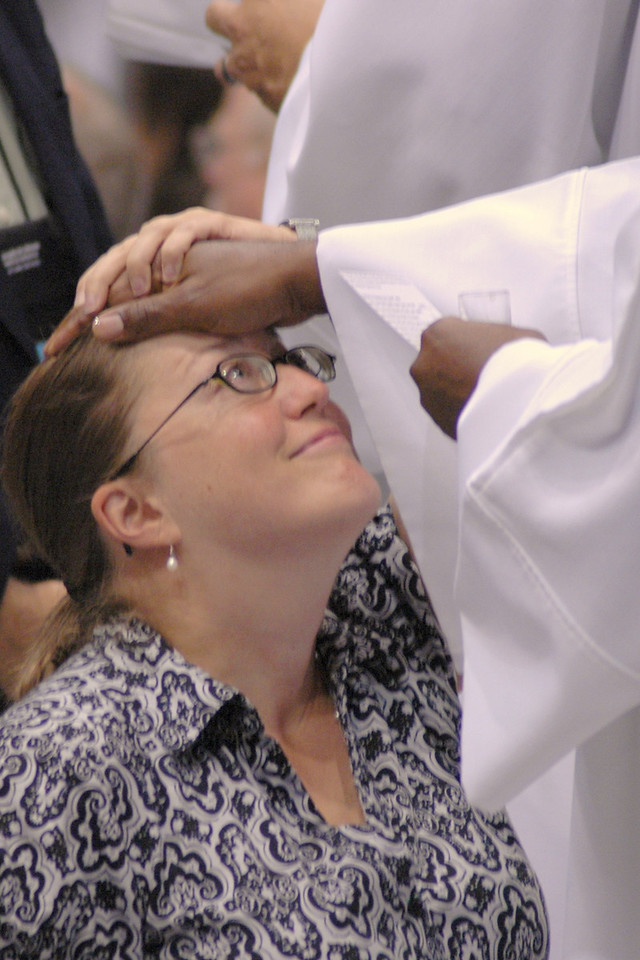 A worshiper is prayed over during Friday's worship.