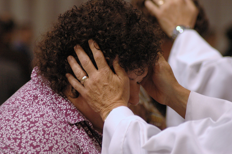 The laying-on of hands during Friday's worship service.