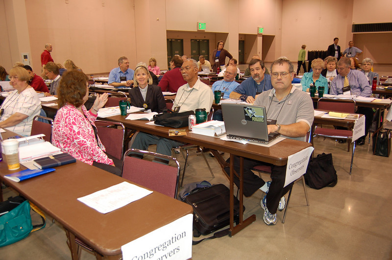 Congregational observers in the assembly hall.