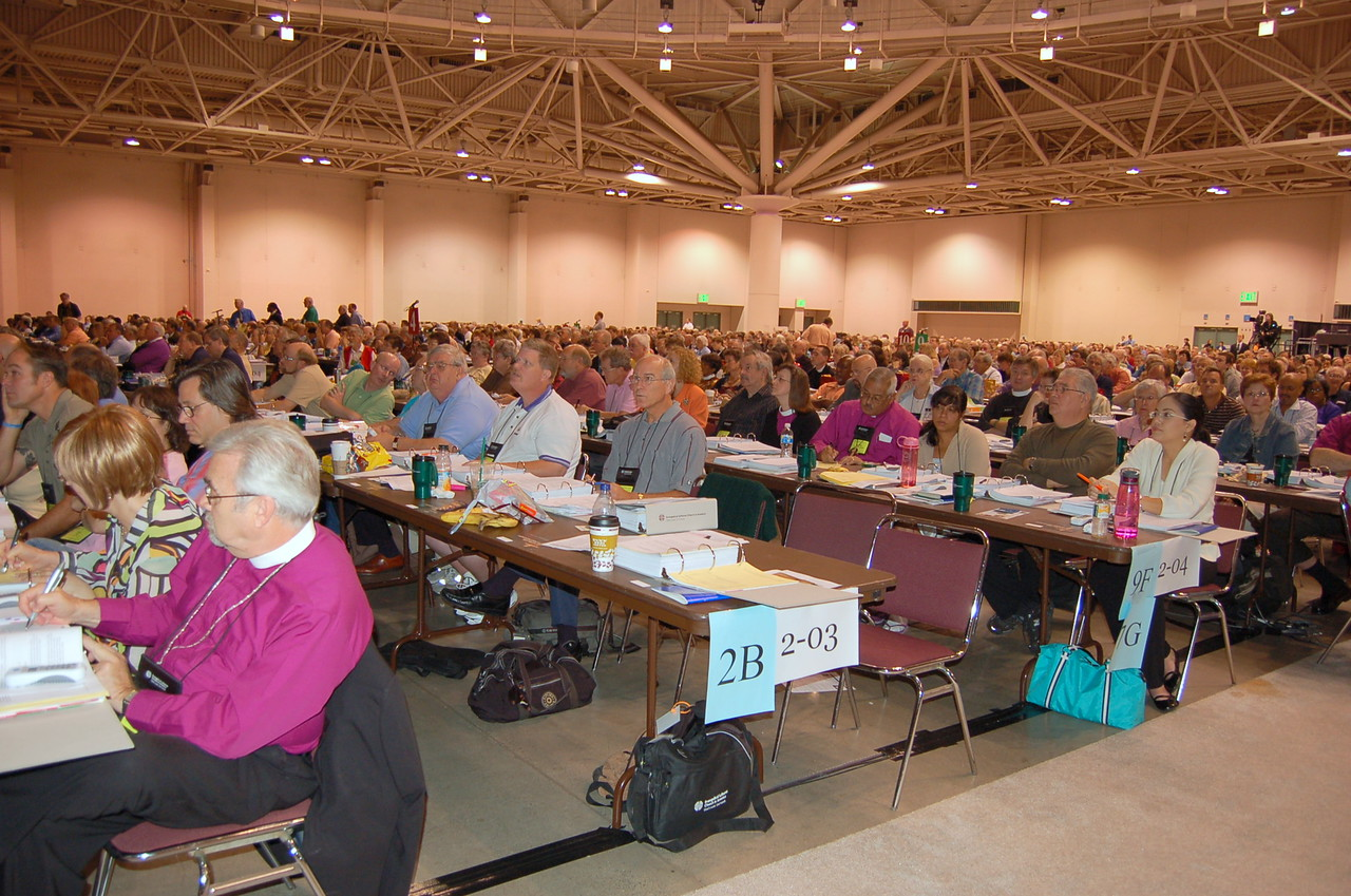 Voting members listen to the results of a vote.