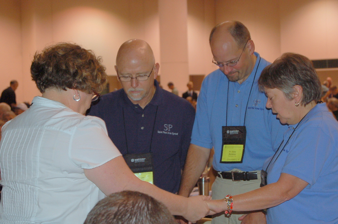 Voting members from the Saint Paul Area Synod pray together before voting at the 2009 ELCA Churchwide Assembly.