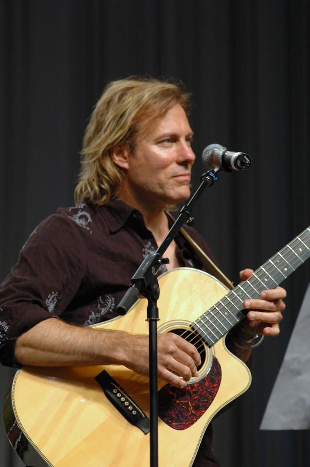 Mr. Peter Mayer accompanies Ron Glusenkamp on the Guitar during the Bible study.
