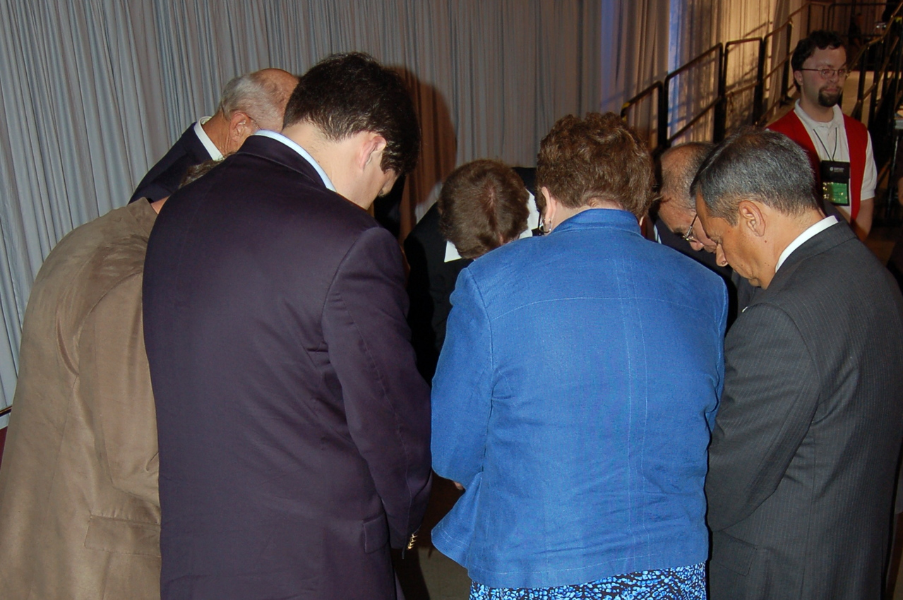 A quick prayer behind the stage.