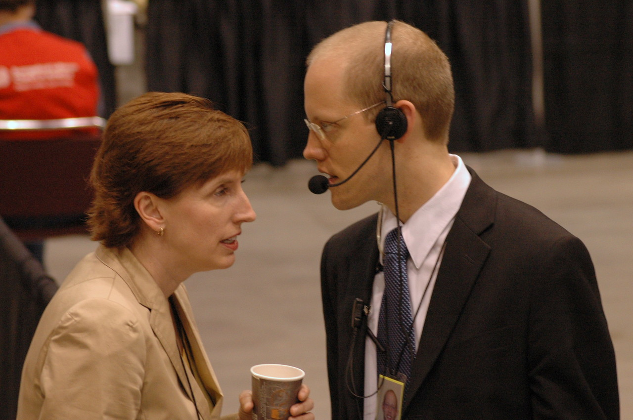 Marianne Griebler, associate director for marketing - member communications and storytelling confers with Scott Hendrickson, director for marketing, public relations and creative services.