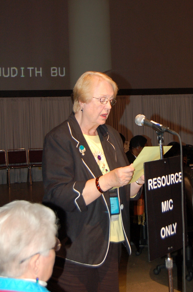 Reading a prayer during plenary section nine.