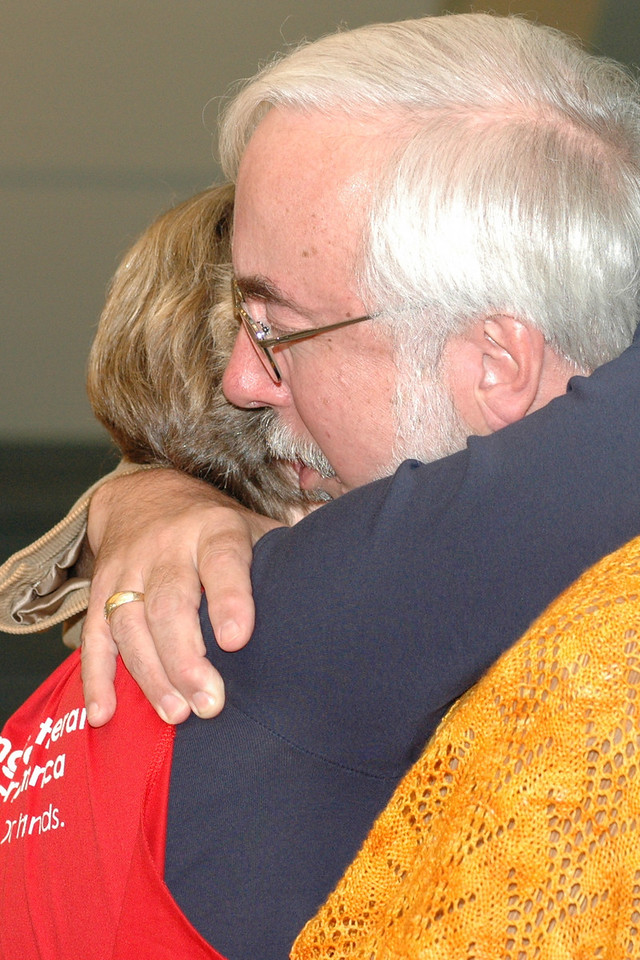 A Voting Member hugs a volunteer after the adoption of the Ministry Policy Recommendation.