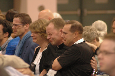 Visitors react to the adoption of the ministry policies document during plenary session nine.