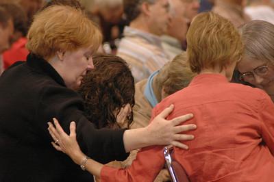 Voting members praying