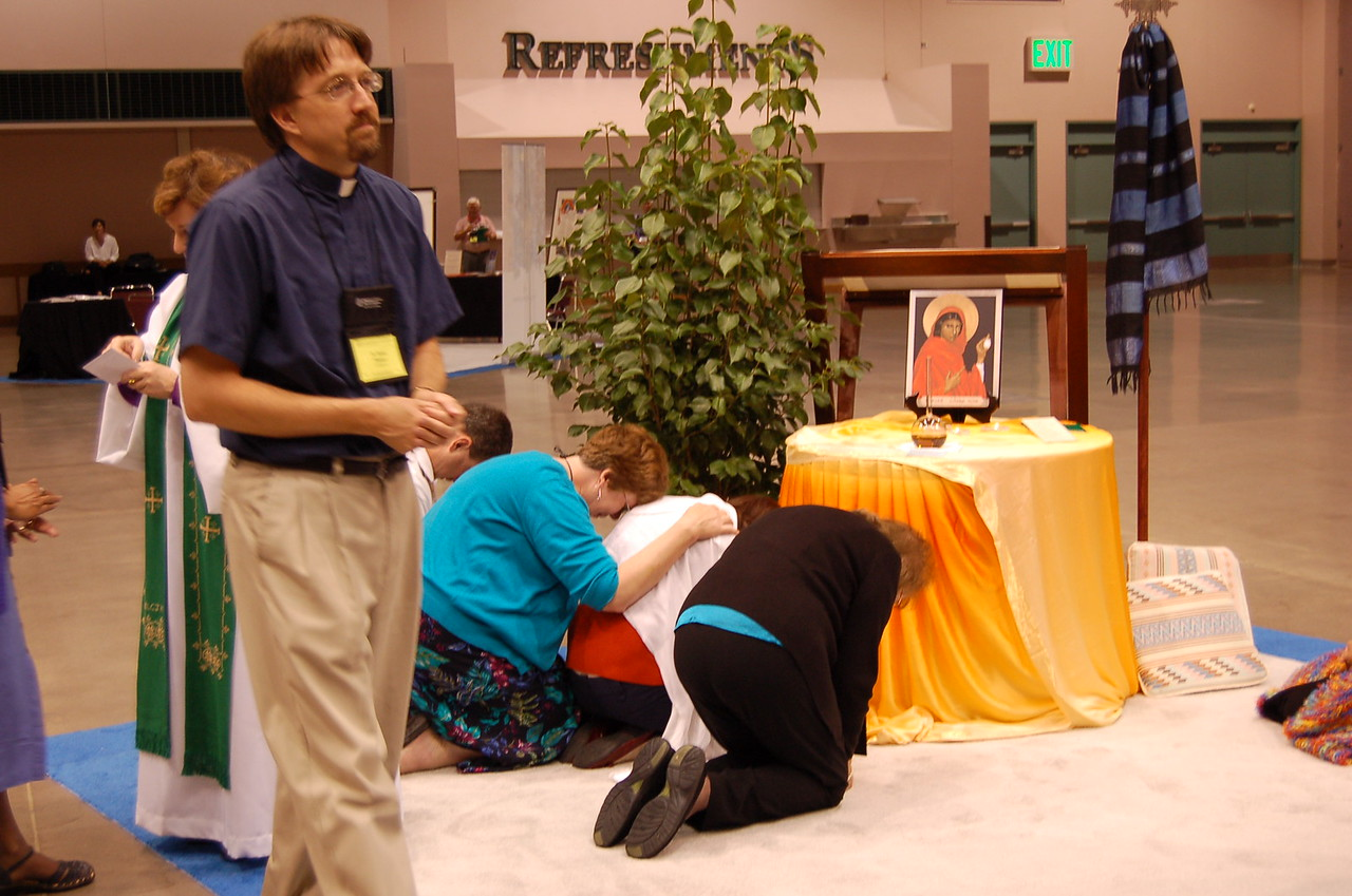 Praying before the chrism oil.