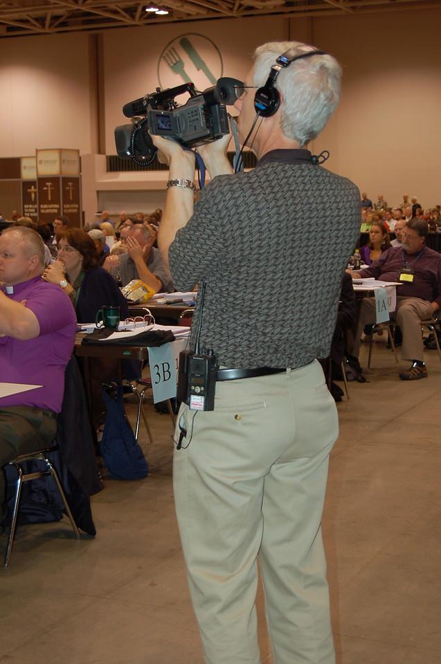 Mark Johns running a camera.