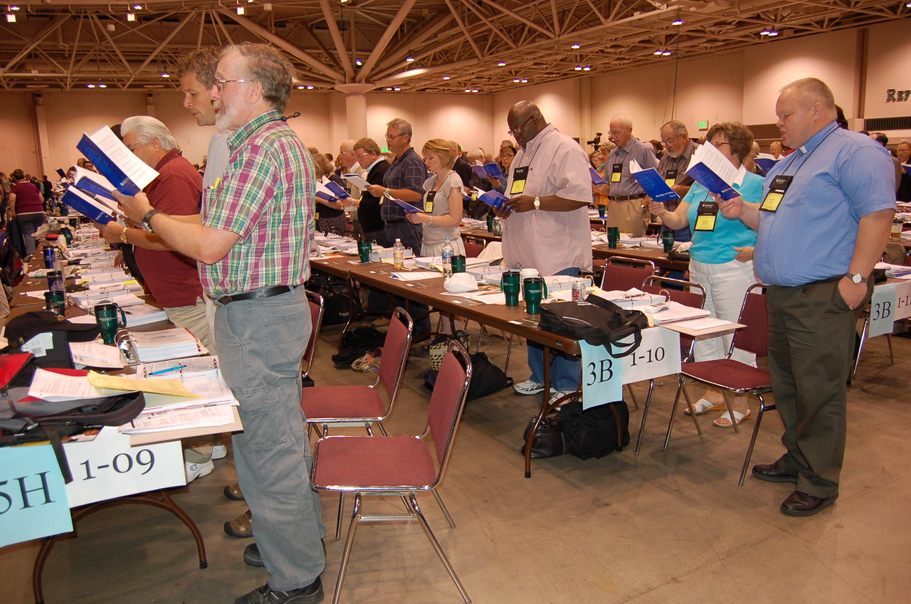 Voting members of the Northwest Synod of Wisconsin and the Eastern North Dakota Synod sing during plenary.