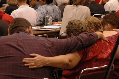Voting members praying before voting.