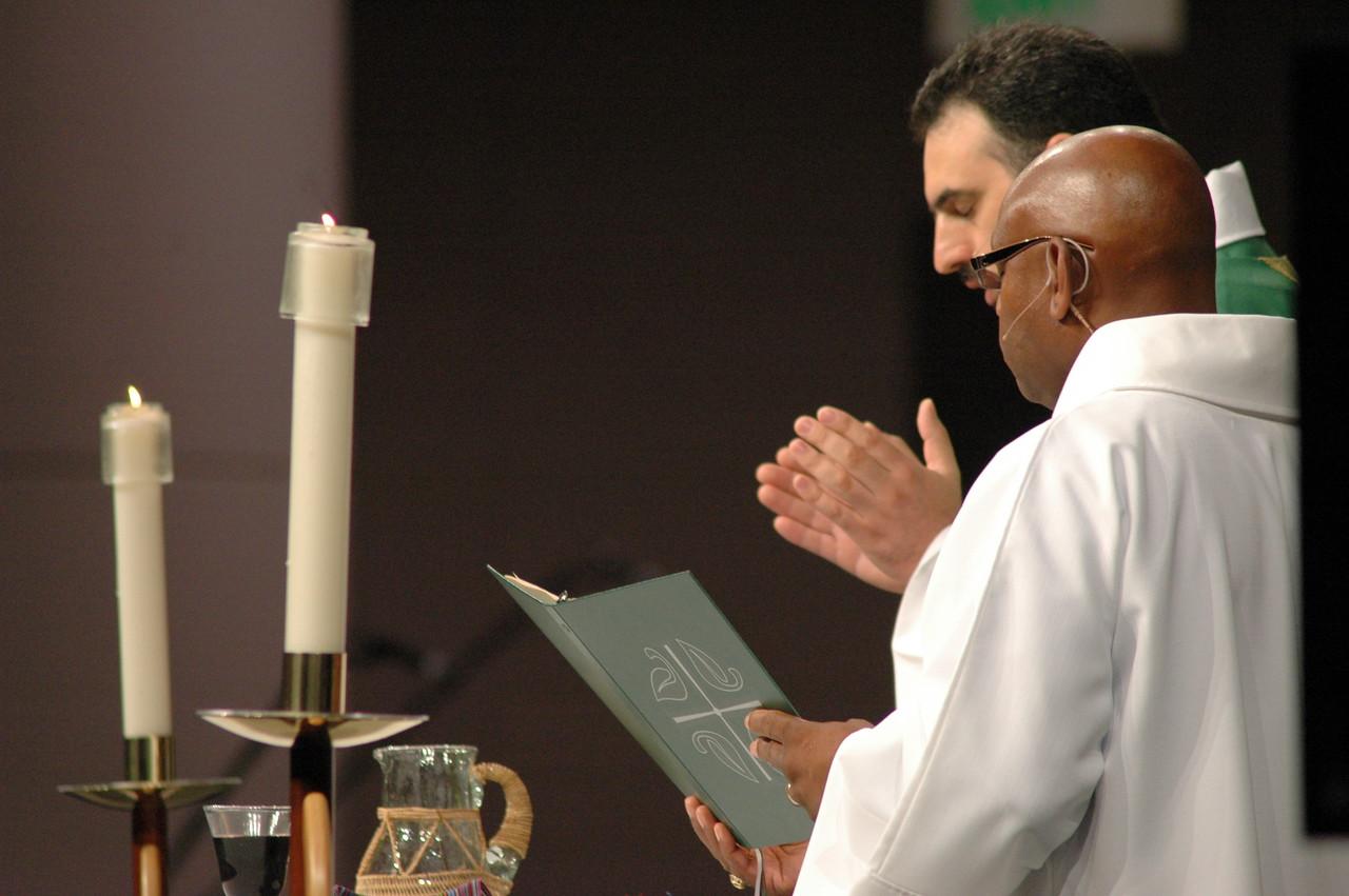 Mr. William Horne, assisting minister and the Rev. Rani Abdulmasih, presiding minister.