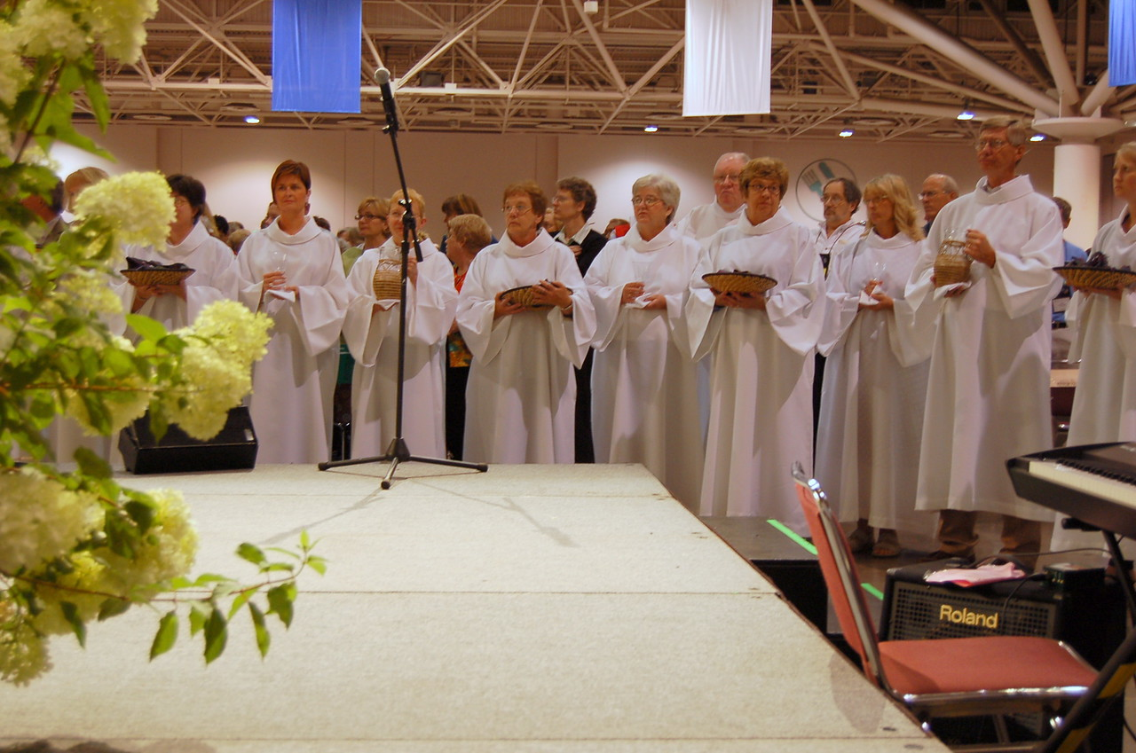 Parish nurses from area congregations serve as communion ministers during today's worship service.