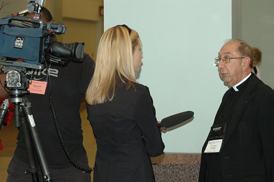 The Rev. Paul Spring being interviewed by a television station after the Ministry Policy Recommendation.