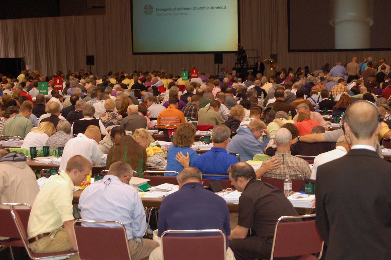 Praying during plenary session nine.