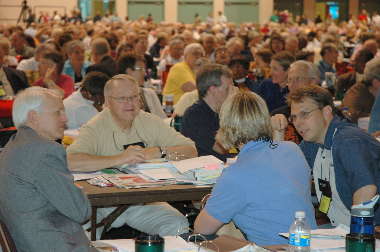 Voting members talk amongst themselves during Bible study.