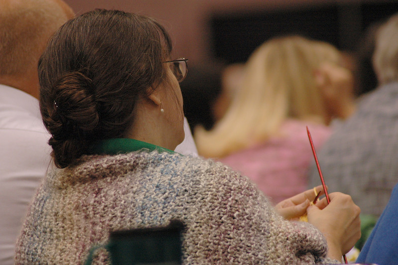 Knitting during plenary session eight.