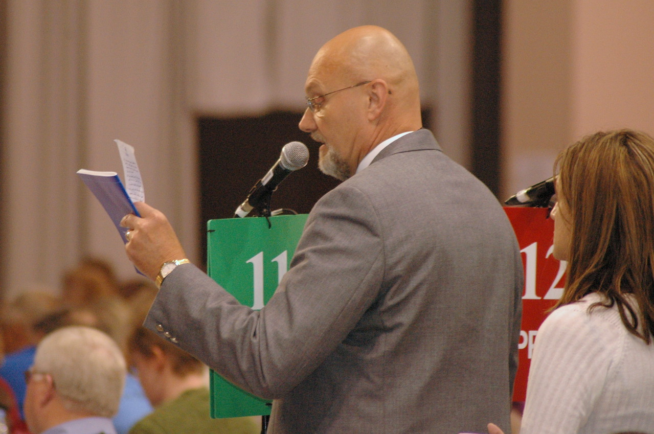 A voting member speaks to an issue at plenary session eight.