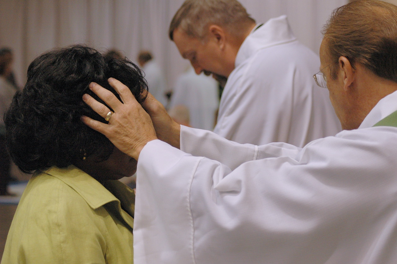 Making the sign of the cross with chrism oil in remembrance of one's Baptism.
