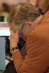 A voting member takes a moment to pray before voting.