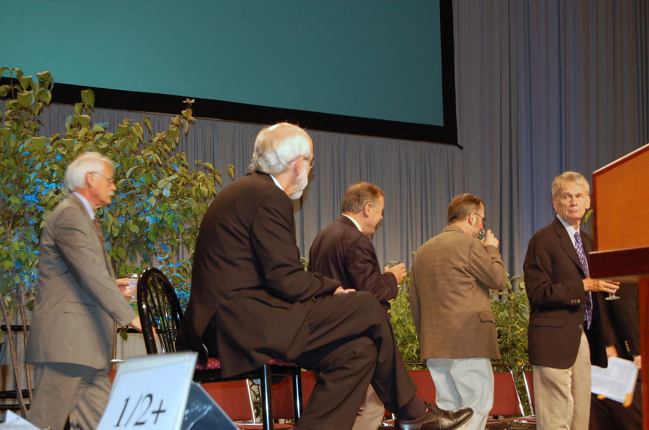 The Rev. Stan Olson (right), executive director, Vocation and Education, readies himself to go up to the stage.