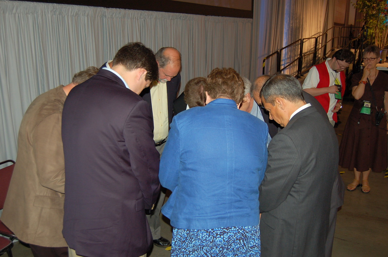 A quick prayer behind the stage. Vice-President Pena is seen on the right.