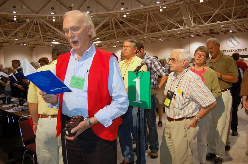 Volunteer Leonard Flachman sings during plenary.