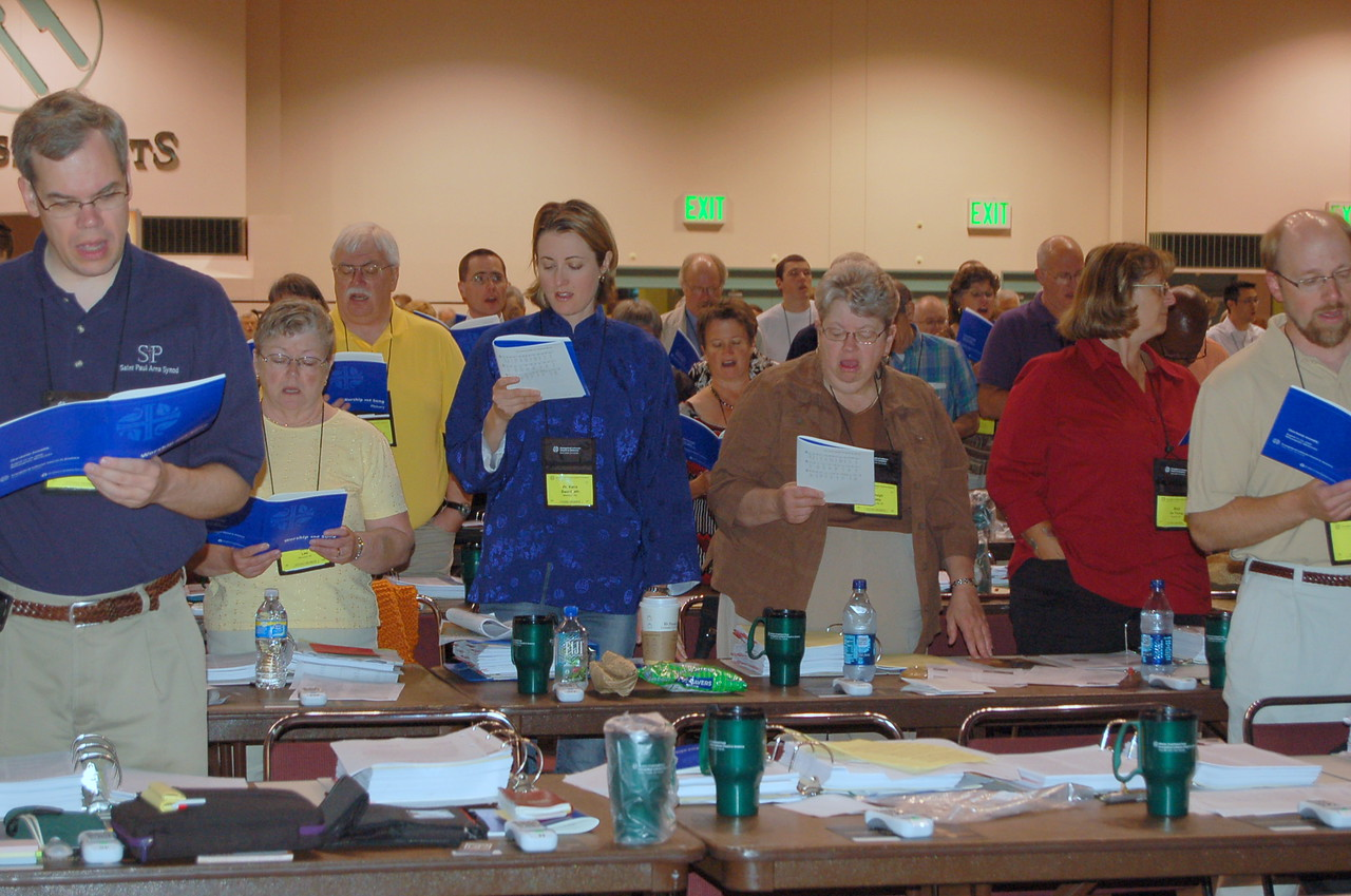 Voting members sing a hymn during Friday morning's plenary session.