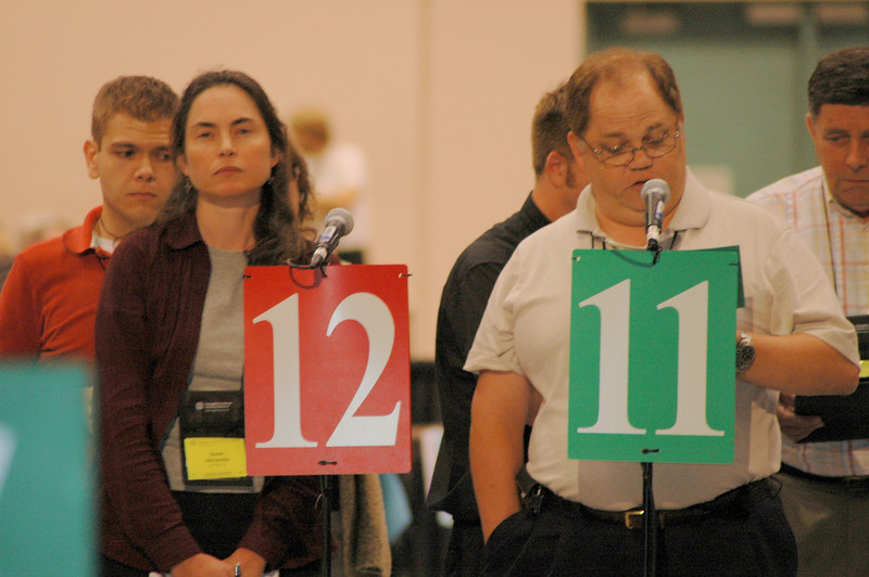 A voting member waits her turn to speak.