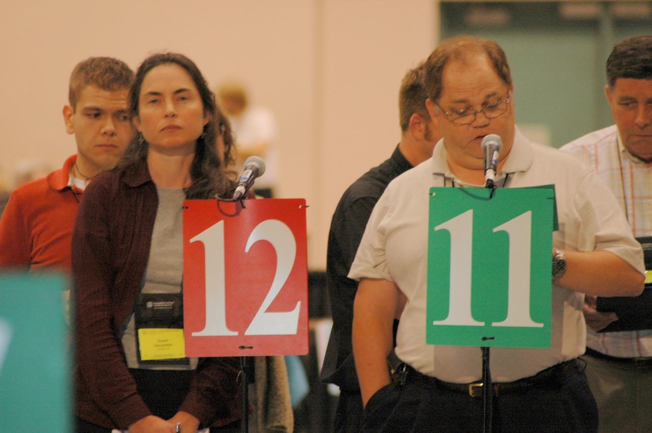 A voting member waits her turn to speak.