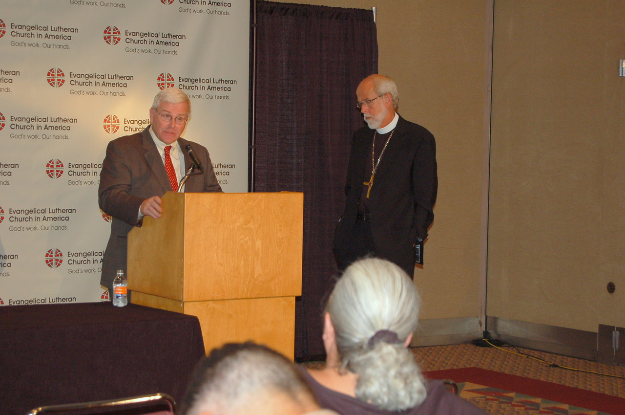 John Brooks, director for ELCA news services, during the news conference. Bishop Hanson looks on.