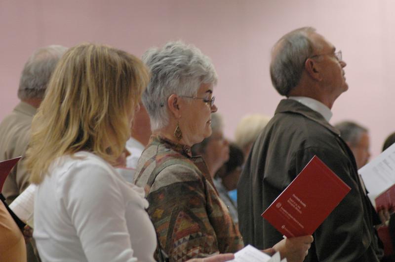 Ione Hanson (center), wife of Presiding Bishop Mark S. Hanson, at opening worship.
