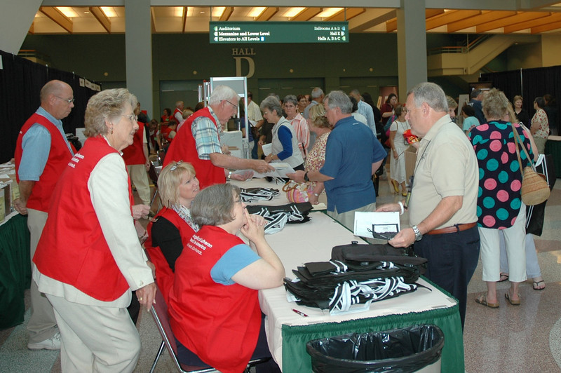 Volunteers assist a voting member.