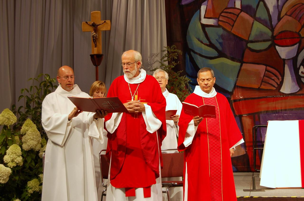 Presiding Bishop Mark S. Hanson preaches at opening worship. Treasurer Christina Jackson-Skelton, Secretary David Swartling, and Vice-President Carlos Pena follow in the liturgy.