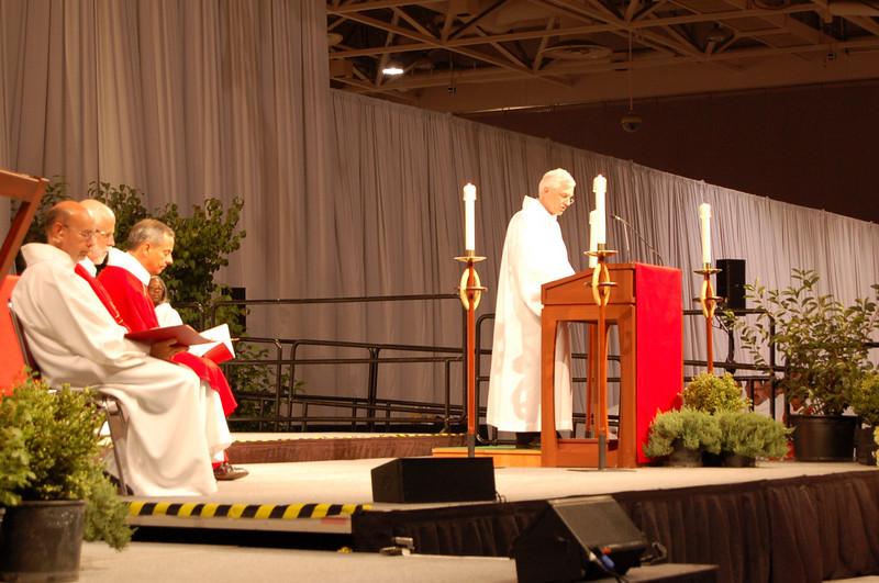 Secretary David Swartling reading during opening worship.