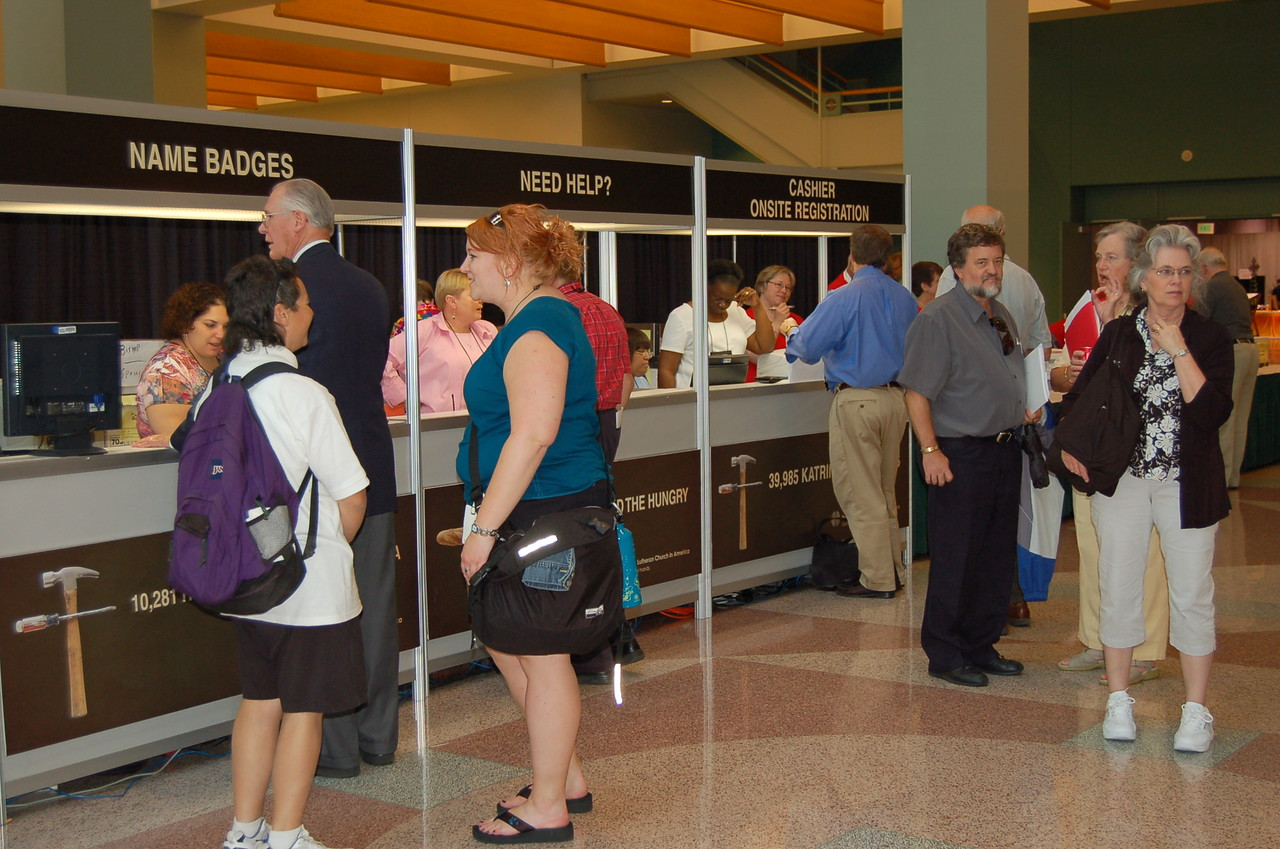 Voting members and visitors picking up their registration materials.