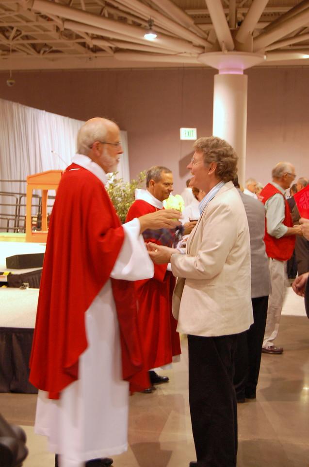Presiding Bishop Mark S. Hanson distributing Holy Communion.