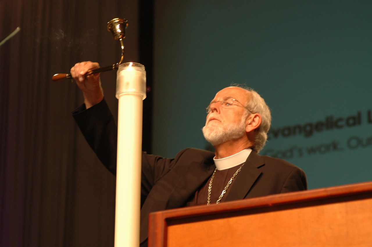 Lighting the candle, Presiding Bishop Mark S. Hanson opens the 2009 Churchwide Assembly.