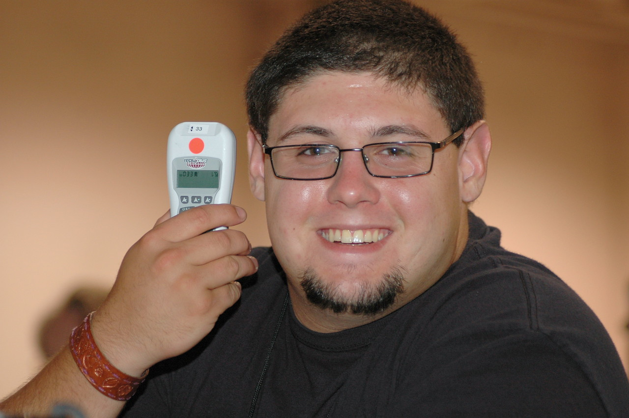 Voting Member Jared Johnson of Windsor, New Jersey, displays the new wireless handheld voting machines. No more wires to trip on!