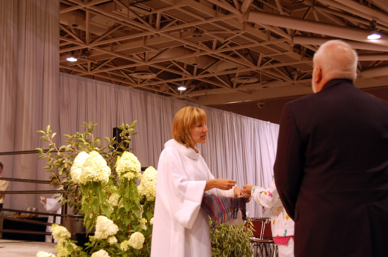 Treasurer Christina Jackson-Skelton distributing Holy Communion.