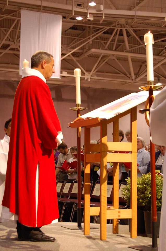 Vice-President Carlos Pena reading during opening worship.
