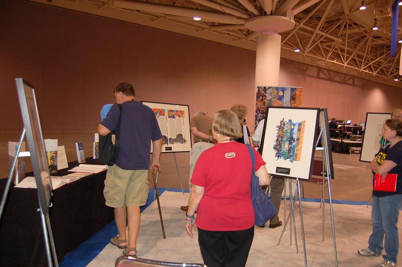 Visitors looking at the Saint John's Bible display.
