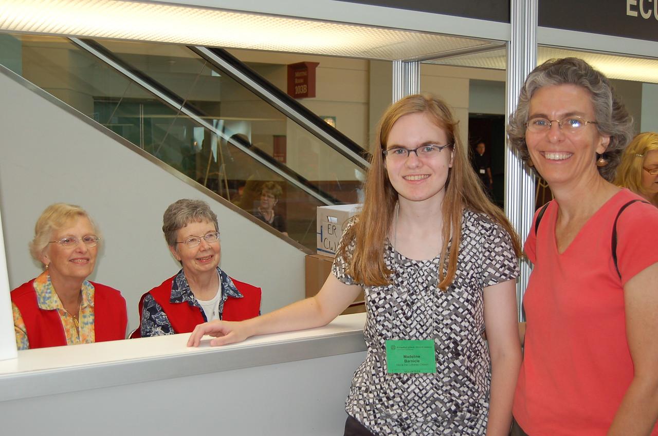 Madeline Barnicle at the registration desk.