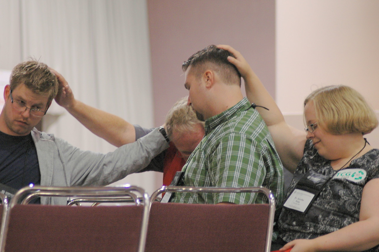 The laying on of hands at opening worship.