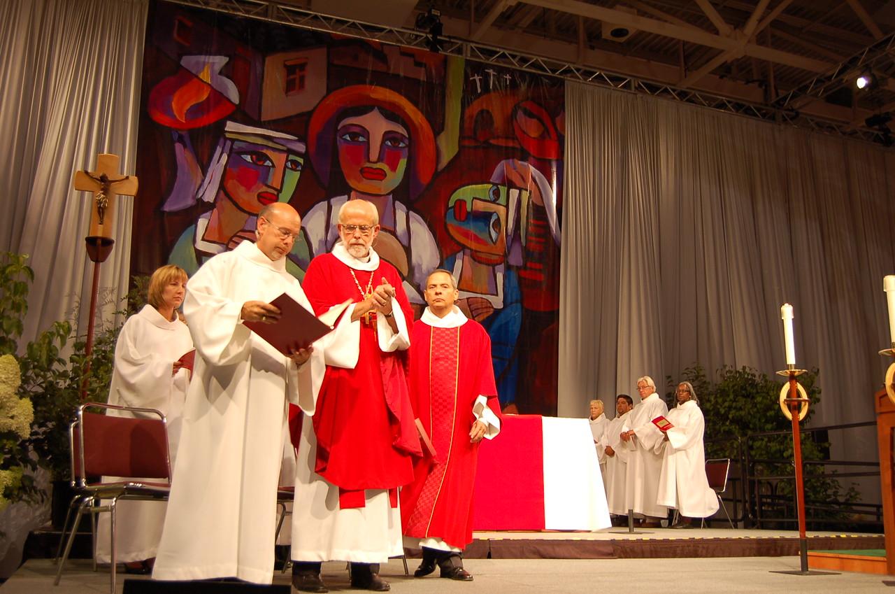Presiding Bishop Mark S. Hanson at opening worship. Treasurer Christina Jackson-Skelton and Vice-President Carlos Pena look on.