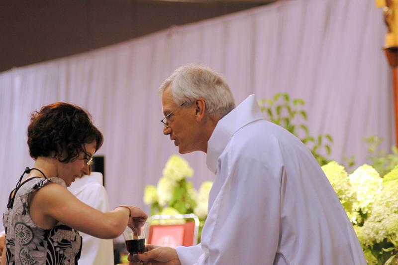 Secretary David Swartling distributing Holy Communion at opening worship.
