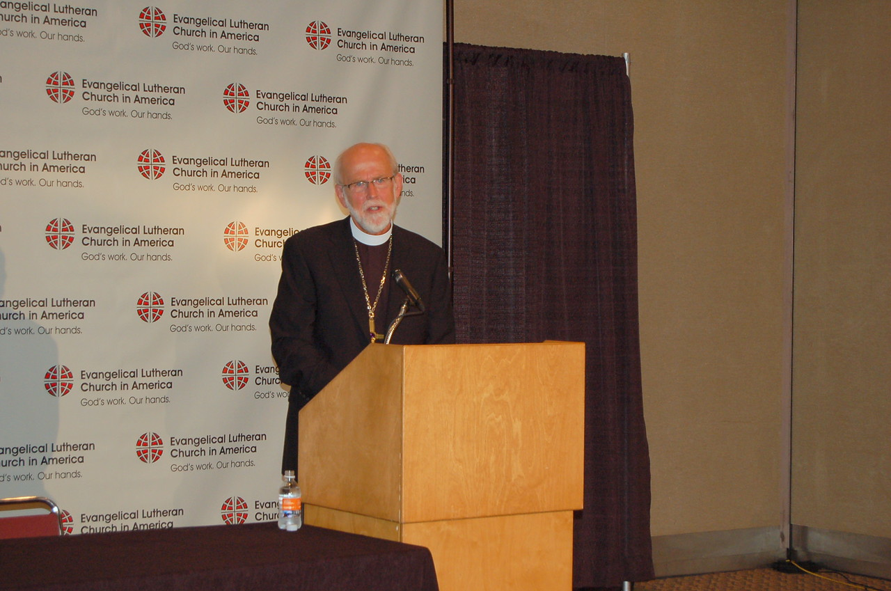 Presiding Bishop Mark S. Hanson addresses a group of reporters at Monday's news conference.
