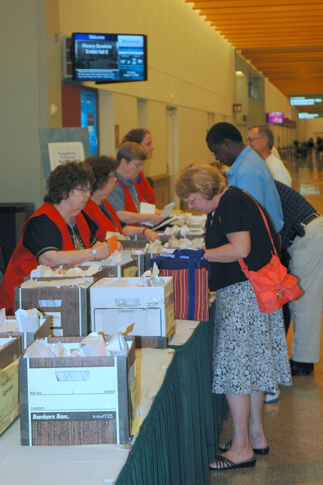 Voting members pick up their registration packets.